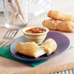 """Here's a great way to dress up mozzarella sticks...just try this baked version that uses golden puff pastry as the """"breading"""". You'll find that the melted mozzarella together with the flaky pastry is a delectable combination."""