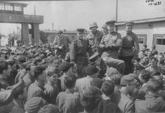 Soviet and American soldiers appear before the release of prisoners - prisoners of war from different countries in a German concentration camp Mühlberg (Mühlberg). Concentration camp was liberated by Soviet troops 23 April 1945. Near Soviet officer (descending) military photojournalist Alexander Ustinov (1909-1995).