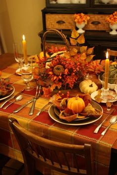 A table setting in colors like orange or red and brown will feel warm and cozy