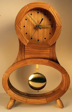 I made this desk clock from small white oak pieces glued together. The wood is finished with Danish oil.