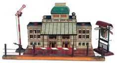 German lithographed tin train station and accessories attributed to Gebrüder Bing, circa 1920.