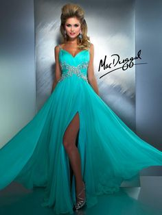 Sassy and classy, this dress says it all!  Spaghetti straps are adorned with tiny sequins.  Rouched bust and waistline.  Crystals accent front and carry around to back of dress making this gown oh so elegant.