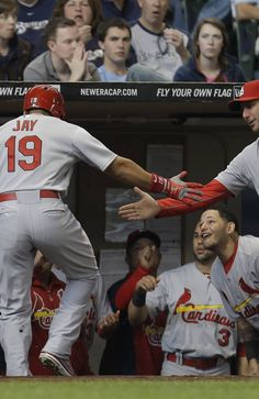 Jon Jay celebrates outside the Cardinals dugout after hitting a three run homer in the top of the second inning against the Milwaukee Brewers.  Cards won the game 7-6.  5-04-13