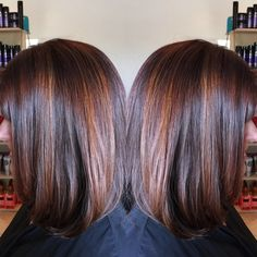Dark red brown base with penny copper highlights. Long bob. By Denise Suttlemyre/Xquisite Salon&Spa