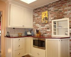 Brick wall kitchen backsplash kitchen design ideas with a faux brick wall built in eclectic kitchen . Brick Wall Paneling, Faux Brick Panels, Brick Accent Walls, Exposed Brick Walls, Country Kitchen Backsplash, Brick Wall Kitchen, Kitchen Tiles, Kitchen Cabinets, Rustic Backsplash