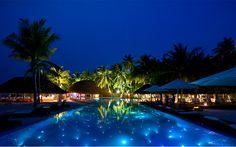 Stunning night view of the infinity pool at Kuramathi island resort