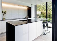 stylish black&white kitchen with Silestone Tao worktop  by Interioo