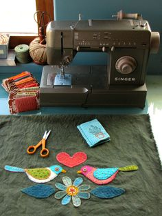 """""""lola"""" and lola's sewing machine cover.  geninne's (http://blogdelanine.blogspot.com/) sewing machine--gosh i love it!  reminds me of my grandma's old singer that i loved to sew on--sturdy, reliable, wonderful feel.  love the color of lola!"""