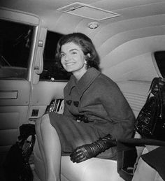 Portrait of Jackie Kennedy sitting in a car in New York City leaving the Carlyle Hotel's private entrance, 1963