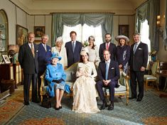 The royal family, along with Carole, Michael, Pippa, and James Middleton, pose with Kate Middleton, Prince William, and Prince George after George's Oct. 23 christening