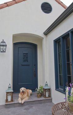 The exterior is Merlex Stucco in Benjamin Moore Navajo White; Exterior trim & door paint color is Benjamin Moore Blue Note.