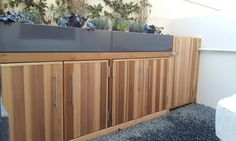 Western Red cedar and metal planters used to create a front garden bin storage unit