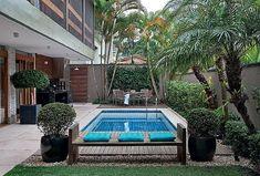 A modern backyard in Sao Paulo by  Odilon Claro. #pool