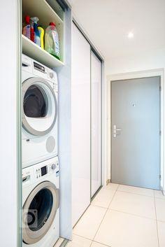 Realizace kompletního interiéru bytu 2+kk v Plzni. Montáž laminátové podlahy světlé barvy pro projasnění interiéru. Dveře v podobném odstínu s podlahou… Stacked Washer Dryer, Washer And Dryer, Laundry, Home Appliances, Kitchen, Ideas, Laundry Room, House Appliances, Cooking