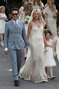 KATE MOSS Kate asked her friend John Galliano to design her vintage inspired wedding dress.