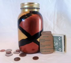 This Red & Gold Mason Jar Bank is a great way to teach any little ones how to save money. The mason jar bank is a great way to teach them the value of money and to teach them patience. But this bank isnt just for kids, adults can use it too! Toss in any spare change into the bank and save up for that concert youve been wanting to go to, for that road trip youve been talking about!  The bank is made from a quart sized mason jar and painted with acrylic paint. Its then sprayed down with a…