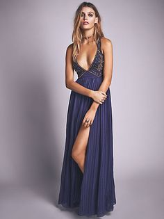 Selma Maxi Dress | This stunning slinky matte jersey maxi dress features a high neck and a dramatic open back.  Hidden side zip and a button closure at the back neck.  Statement front slit.