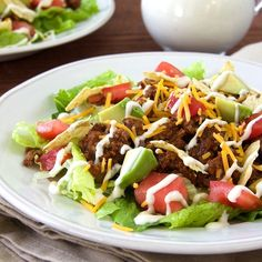 Layer flavorful taco meat with lettuce, tomato, avocado, shredded cheese and tortilla chips for an easy family-pleasing taco salad.