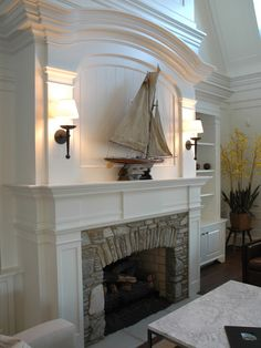 Beautiful woodwork surrounding a stone fireplace | A Lakeside Shingle Style Estate