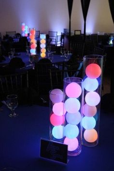 Color Changing LED Deco Balls stacked in glass cylinder vases makes for super cool DIY light up table centerpieces, ideal modern wedding decor. Our LED orbs are perfect for this: Led Centerpieces, Bat Mitzvah Centerpieces, Kitty Party, Deco Led, Blacklight Party, Harry Potter Halloween, Neon Glow, Sweet 16 Parties, Party Lights