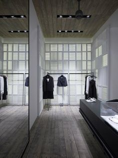 Retail: the contemporary interior of Linea Piu, Mykonos, designed by Kois Associated Architects > great wall treatment.