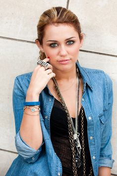 Miley....http://xcelebrity.net/wp-content/uploads/2011/12/Miley-Cyrus-Charles-Sykes-Photoshoot-2010-4.jpg