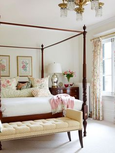 Feminine Chic - This bedroom's warm, off-white walls are the perfect backdrop for dark wood furnishings and bright floral accents. Dark wood furniture is a popular option in neutral rooms because it acts as an anchor when paired with other neutral colors.