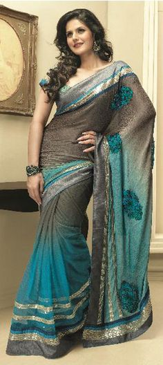Jacquard, Half Crepe, Half Net Bollywood Style. Available at http://www.indianweddingsaree.com/product/65925.html
