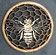 Honey Bee silhouette cut from Oak with a scrollsaw.