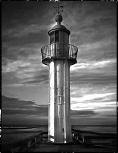 The lighthouse in Trouville, France.  Www.tacatelier.com