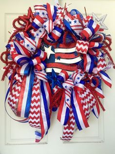 Patriotic 4th of July Red, White, and Blue Summer Mesh Wreath by WilliamsFloral on Etsy https://www.etsy.com/listing/235125479/patriotic-4th-of-july-red-white-and-blue