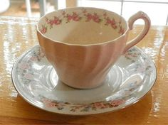 Dainty little roses. I love the shape of the cup! One of my collection (By Nina Eary)