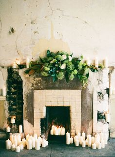 Marble Mantelpiece Draped in Candles and Greenery for a Romantic Wedding Ceremony | Katie Stoops Photography | See More! http://heyweddinglady.com/cashmere-and-champagne-warm-neutral-wedding-inspiration/