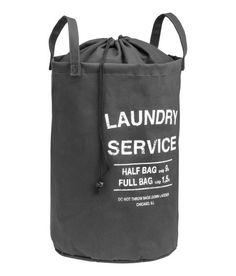 Laundry bag in unbleached cotton twill with a printed text design. 3e63892d047b1