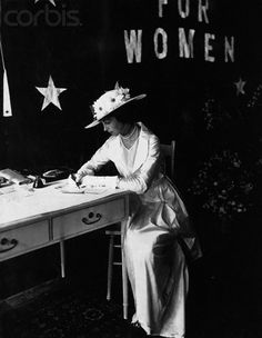 ๑ Nineteen Fourteen ๑ historical happenings, fashion, art style from a century ago - Consuelo Vanderbilt Balsan signs a petition to join a suffrage group in She wears an evening dress and hat.
