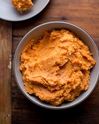 Mashed Sweet Potatoes with Greek Yogurt | Classic mashed sweet potatoes are made even sweeter with a touch of brown sugar and maple syrup, then given a dose of creaminess with a generous dollop of Greek yogurt.