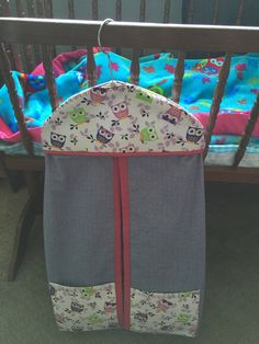 Nifty diaper stacker. Used the free pattern found online from Sew4Home and made it for my daughter's first baby using her owl nursery theme. http://www.sew4home.com/projects/storage-solutions/hanging-diaper-stacker-nursery