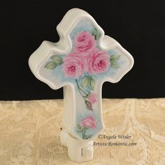 """Beautiful & Functional, I china painted this inspirational cross shaped night light with deep pink roses and a soft aqua background. Measuring 4"""" wide by 6"""