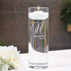 Let your love float above the rest with our statuesque Elegance Monogram Floating Unity Candle. Created as a uniquely designed wedding day must have, this floating candle and personalized vase set make an ideal alternative to the traditional unity candle. You'll easily see how beautiful modern day trends and unfailing traditions look when they are blended together perfectly.It truly is one ceremonial accessory that adds value to your wedding day celebration by allowing you to add its…