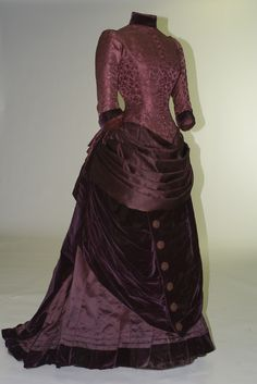 Two-piece dress, G & E Spitzer, Vienna, 1879. Purple silk damask with boned bodice, bustle, and train.