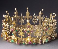 Crown of Zadar; Given to Elizabeth of Bosnia by King Louis I of Hungary. Elisabeth of Bosnia( Bosnian : Elisabeta Kotromanić, (1339 - 16 January 1387). She was Queen of Poland and Hungary, married King Louis I King of Poland and Hungary. Crown in yellow gold with primarily emeralds and rubies. Beautiful example of a rare middle-ages crown.