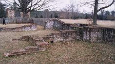 The foundations of row houses have been excavated in New Towne, where the Jamestown settlers expanded to live in the 1620s and built more substantial homes. Visitors can explore this section of Jamestown and see the scattered remains of this historical settlement. (Flickr/Marc Carlson)