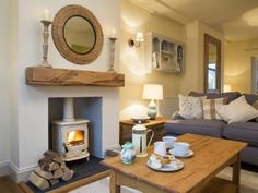 The cosy and luxurious sitting room at Plum Tree Cottage in Keswick. The owner i… The cosy and luxurious sitting room at Plum Tree Cottage in Keswick. The owner is an interior designer and the house is beautifully furnished throughout. Cottage Living Rooms, Cottage Interiors, New Living Room, Home And Living, Living Spaces, Cosy Living Room Small, Modern Living, Cream Living Room Decor, Blue And Cream Living Room