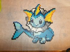 Chibi Vaporeon with picture bracket, $10 with $3 shipping at The Craft Garrison