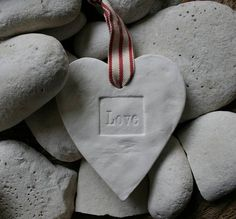 Love heart ornament amongst stones. Valentine Day Love, Valentines, Concrete Projects, Butterfly Kisses, Sticks And Stones, Hanging Hearts, Love Symbols, Felt Hearts, Wedding Art