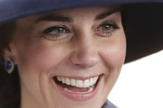 Kate Middleton Photos Photos - Catherine, Duchess of Cambridge smiles as she meets veterans and serving members of the British armed forces at a reception following the unveiling of the new memorial to members of the armed services who served and died in the wars in Iraq and Afghanistan at Victoria Embankment Gardens on March 9, 2017 in London, England. - Dedication