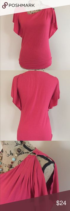 💋 WHBM flutter sleeve knit top 💋 Beautiful raspberry red flutter sleeve top by WHBM. Crew neck with one open shoulder and silver accent ring. Size XS (0-4). 95% rayon 5% spandex. Very soft. Excellent condition White House Black Market Tops Blouses