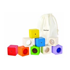 This bright, colourful set of 9 sensory building blocks consists of 3 visual blocks, 3 auditory blocks & 3 texture blocks. A classic wooden toy to encourage motor skills and creativity. Scandiborn - the best UK supplier of wooden Plan Toys. Cubes, Sensory Blocks, Kinesthetic Learning, Eco Brand, Plan Toys, Toys Online, Worlds Of Fun, Child Development, Bag Storage