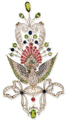 AN UNUSUAL ANTIQUE DIAMOND AND GEM-SET PEACOCK BROOCH Centering upon an old European-cut diamond peacock, with pavé-set demantoid garnet head, enhanced by circular-cut ruby crest, and cabochon ruby accent eye…circa 1890