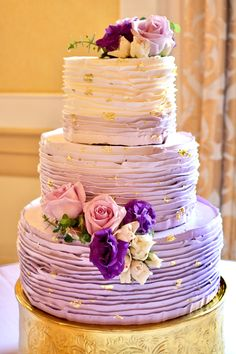 Purple ombré ruffled buttercream wedding cake with gold leaf flakes by Sablée!